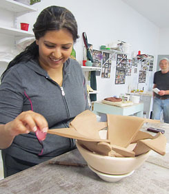 Handbuilding a free-form object from clay.