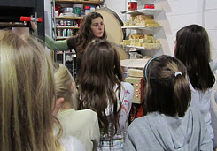 Girl Scouts learn about the process of storing, forming and firing clay.