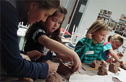 Handbuilding with clay during an after school class for children
